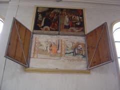 Der alte St. Jost-Bilderzyklus in der Kirche St. Jost in Blatten bei Malters erscheint hinter den hölzernen Tafeln des neueren Bilderzyklus. (Bild: PD)