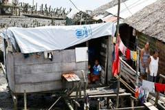 In der Stadt Tacloban wurden die Häuser durch Haiyan zerstört und notdürftig wieder aufgebaut. Mehr als 7300 Menschen verloren ihr Leben im Jahrhundertsturm (Bild: Keystone)