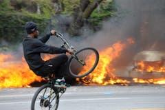 Ein Radfahrer demonstriert – seine Künste. (Bild: Algerina Perna/The Baltimore Sun via AP)