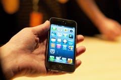 Am Design hält Apple auch mit dem neuen Modell fest: Jetzt passt aber eine weitere App-Reihe aufs Display. (Bild: Keystone)