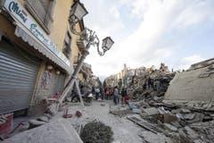 Eingestürzte Häuser in Amatrice. (Bild: EPA / Massimo Percossi)