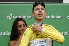 Der Deutsche Tony Martin verteidigt erfolgreich das Gelbe Trikot des Gesamtführenden. (Bild: Keystone)