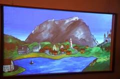 Bei der Beamer-Animation von Raphael von Matt wird die Landschaft Bild für Bild, Bauwerk um Bauwerk zubetoniert. (Bild: Romano Cuonz/Neue NZ)