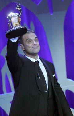 """Im November 2013 wird Robbie Williams in Berlin mit einem Bambi in der Sparte """"Entertainment"""" geehrt. (Bild: Keystone)"""