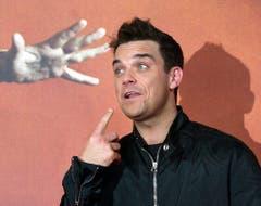 Können diese Augen lügen? 2002 unterzeichnet Robbie Williams mit der Plattenfirma EMI einen rekordverdächtigen Deal: Der Künstler erhält für vier Alben 80 Millionen britische Pfund. (Bild: Keystone)
