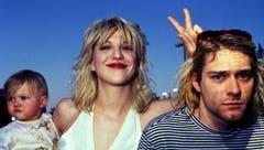 Keine happy family: Kurt Cobain mit seiner Frau Courtney Love und der gemeinsamen Tochter Frances Bean. Fans behaupten noch heute, Courtney habe Kurt in den Selbstmord getrieben. (Bild: pd)