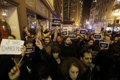 Auf der ganzen Welt gingen die Menschen für die ermordeten Journalisten und Polizisten auf die Strasse. (Bild: Keystone)