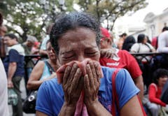 Eine Anhängerin von Chávez reagiert, als sie vom Tod des Präsidenten erfährt. (Bild: Keystone)