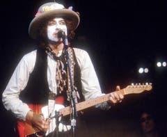 Kaum zu erkennen: Dylan bei einem Konzert im Madison Square Garden in New York am 8. Dezember 1975. (Bild: Keystone)