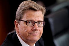 Der frühere FDP-Politiker erfreute sich im Mai 2013 im deutschen Kabinett noch bester Gesundheit. (Bild: Keystone)