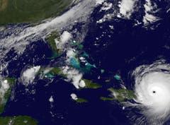 Auf dieser Satelliten-Aufnahme ist der enorm grosse Hurrikan kurz vor dem Auftreten auf Puerto Rico zu sehen. (Bild: NASA/NOAA GOES Project)