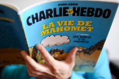 """""""Das Leben Mohammeds"""": Aufnahme der hoch umstrittenen Spezialausgabe von """"Charlie Hebdo"""" vom Januar 2013. (Bild: Keystone)"""
