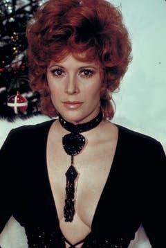 In «Diamonds Are Forever» (1971) arbeitet Tiffany Case (Jill St. John) erst für Bösewicht Blofeld, erliegt dann aber dem Charme von James Bond. (Bild: Keystone)