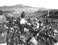 Zerstörte Buddha-Statuen in einem Tal in der Nähe von Nagasaki. (Bild: Keystone)