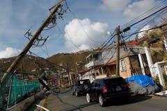 Umgeknickte Strommasten in Charlotte Amalie auf St.Thomas, einer der Virigin Islands. (Bild: Keystone)