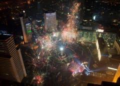 Auch in Jakarta wird kräftig Geld in die Luft geblasen. (Bild: Keystone)