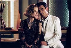 """Zusammen mit Schauspielerin Nicole Kidman covert Robbie Williams 2001 den Frank-Sinatra-Klassiker """"Somethin' Stupid"""". Der Song und das Album """"Swing When You're Winning"""" werden ein Verkaufsschlager. (Bild: Keystone)"""