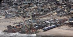 Nach dem Sturm sind die Schäden an der Küste von Seaside Heights in New Jersey gut sichtbar. (Bild: Keystone)