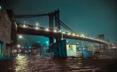 Überflutete Strassen in Brooklyn. (Bild: Keystone)