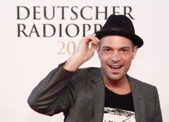 Der Sänger Roger Cicero posiert am 08. September 2011 in Hamburg vor der Verleihung des Deutschen Radiopreises auf dem roten Teppich. (Bild: Keystone)