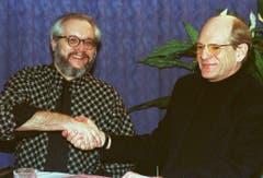 Präsident Thomas Müller (links) begrüsst den neuen Trainer John Slettvoll. (Bild: Keystone)