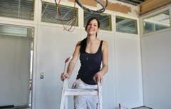 Ein Lächeln für die Fotografin auf der Baustelle. (Bild: Nana do Carmo)