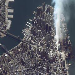 Die Rauchfahne des Anschlags war auch aus dem Weltall auf Satelitenbildern zu sehen. (Bild: Keystone)
