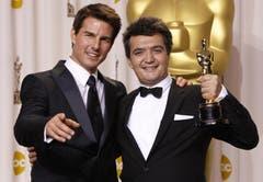 «The Artist»-Produzent Thomas Langmann zusammen mit Tom Cruise (l.). (Bild: Keystone/EPA)