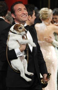Jean Dujardin mit seinem Hund Uggie. (Bild: Keystone)