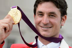 Steve Guerdat, Gold im Springreiten Einzel, 2012 in London. (Bild: Keystone / Laurent Gilliéron)