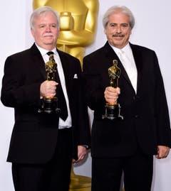 Bub Asman (l.) and Alan Robert Murray mit dem Oscar für den besten Tonschnitt («American Sniper»). (Bild: Keystone / Paul Buck)