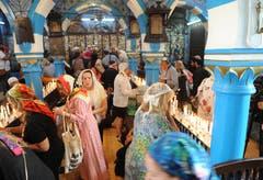 Jüdisches Pilgerfest zur Ghriba-Synagoge auf der Insel Djerba - Beter innerhalb der Synagoge.(Fotografin: Katharina Eglau)