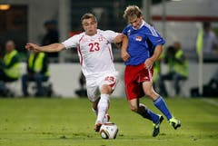 Switzerland's Xherdan Shaqiri, left, fights for the ball with Liechtenstein's Martin Rechsteiner during a friendly soccer match between Liechtenstein and Switzerland at the Rheinpark Stadium in Vaduz, Liechtenstein, Wednesday, August 10, 2011. (KEYSTONE/Peter Klaunzer)