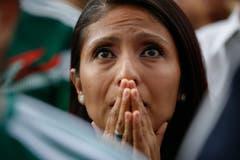 Ein mexikanischer Fan fiebert beim Public Viewing des Spiels von Mexico gegen Brasilien mit. (AP Photo/Anthony Vazquez, Mexico City, 2. Juli 2018)