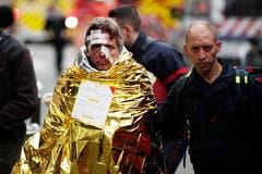 Die Person wurde durch die Explosion verletzt. (Bild: EPA/YOAN VALAT)
