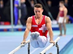 Für Christian Baumann sind die Titelkämpfe in Stettin noch nicht zu Ende, am Sonntag kämpft er am Barren um die Medaillen (Bild: KEYSTONE/EPA PAP/MARCIN BIELECKI)