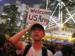 Demonstrant in Hongonk. (Bild: KEYSTONE/EPA/ROMAN PILIPEY)