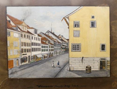 Etwa das Gemälde vom Weinmarkt, das von C. A. Luthiger 1842 gemalt wurde und die Zuger Neugasse zeigt.