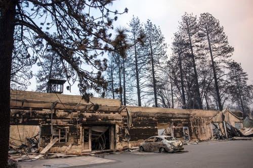 Ausgebrannte Geschäfte im Ortszentrum von Paradise. (Bild: Peter Dasilva/EPA, 11. November 2018))