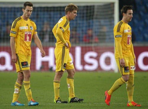 Die Luzerner François Affolter, Florian Stahel und Jérme Thiesson, von links, nach dem Schlusspfiff. (Bild: Keystone)