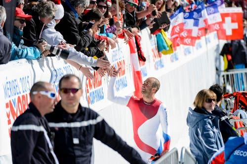 Schöner kann man eine Karriere kaum beenden: Der Walliser Didier Défago schafft es beim Weltcup-Finale in Méribel in seiner letzten Abfahrt nochmals aufs Podest und wird zum Abschluss seiner Karriere Zweiter (19. März). (Bild: (Keystone / Jean-Christophe Bott))