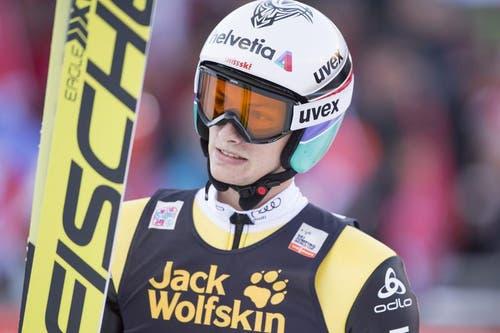 Der Schweizer Gregor Deschwanden nach dem Sprung am Samstag. (Bild: Keystone / Urs Flüeler)