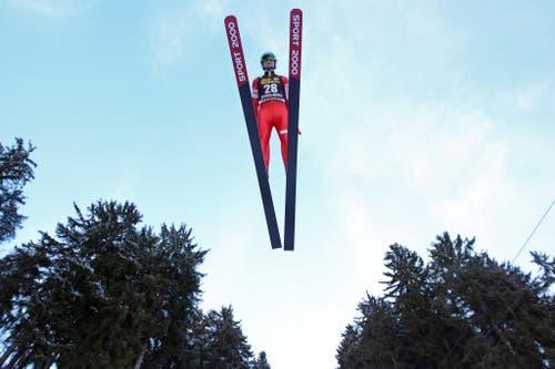 Jan Ziobro, der Sieger des Springens am Samstag 21. Dezember 2013. (Bild: Philipp Schmidli (Neue Luzerner Zeitung))
