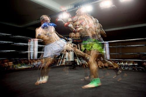 Im Kampf in der Kategorie bis 72 Kilogramm massen sich Philippe Stöckli (grün) und Maziar Hosseinpour (weiss). (Bild: Philipp Schmidli / Neue LZ)