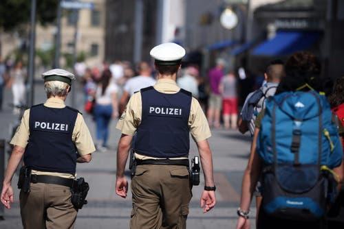 Polizeipräsent in Münchens Innenstadt. (Bild: EPA/Daniel Karmann)