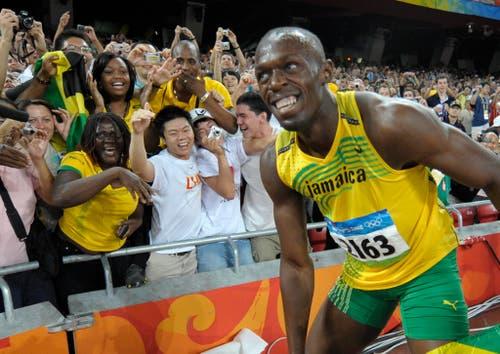 USAIN BOLT. - Mit einer prächtigen Party könnten die Sommerspiele in Rio de Janeiro für Usain Bolt zu Ende gehen. Denn am Schlusstag, am 21. August, feiert der Jamaikaner seinen 30. Geburtstag. Vorher will das Gesicht der Leichtathletik seine Dominanz als Sprinter untermauern. Wie schon 2008 und 2012 will Bolt auch in Brasilien über 100, 200 und 4x100 m den Gold-Hattrick perfekt machen. «Ich werde noch fokussierter als sonst sein», kündigte er an. (Bild: AP / Thomas Kienzle)