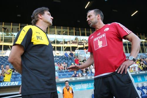 BVB-Sportdirektor Michael Zorc (links) im Gespräch mit Luzern-Trainer Markus Babbel. (Bild: Philipp Schmidli)