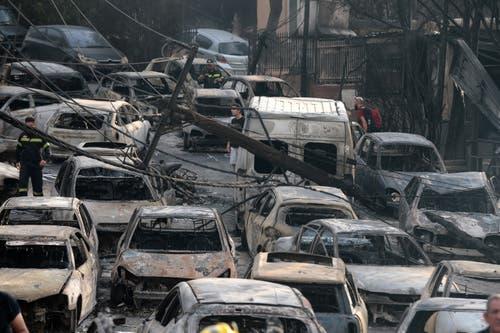 Ausgebrannte Autos. (EPA/Pantelis Saitas, 24. Juli 2018)