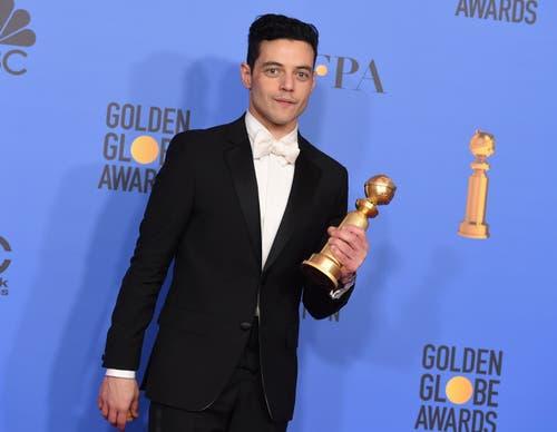 Rami Malek mit seinem Golden Globe für den besten Schauspieler in einem Filmdrama («Bohemian Rhapsody»). (Bild: Jordan Strauss /AP (Los Angeles, 6. Januar 2018))