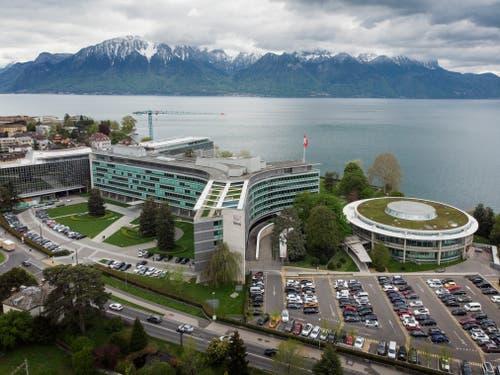 Nestlé, Vevey Der Hauptsitz ist fotogen über dem Genfersee platziert. Architekt: Jean Tschumi Bauzeit: 1959–1960 Bild: Keystone